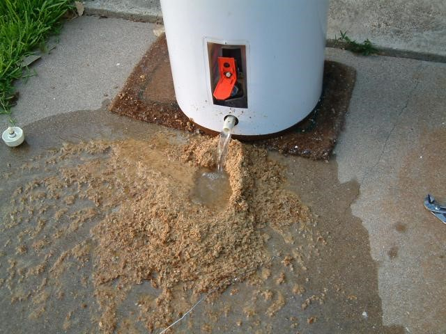 Mesa Plumber draining water heater